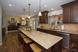 this loveland kitchen features new venetian gold granite counters that brings the kitchen s entire color palette