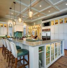 coastal kitchen with l shaped breakfast bar and teal accents