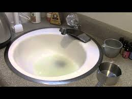 clearing clogged drain with vinegar and