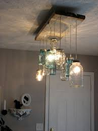 mason jar dining room chandelier maybe better suited for outdoor patio lighting great idea though