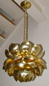 a large brass lotus blossom light pendant or chandelier with one lower light and 3 smaller
