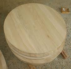 unfinished round table top.