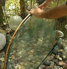 diy waterfall wall old glass table top transformed into a garden ideas gardens and yards water
