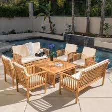 thalia brown 8 piece wood patio conversation set with cream cushions