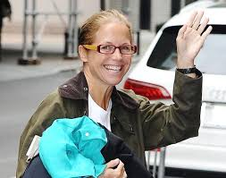 nyc a makeup less katie couric arrives to work on the set of katie