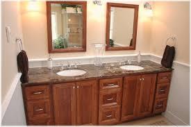 Custom design bathroom vanity, matching mirrors, tub panel cabinetry