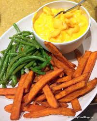 platter of sides mac cheese green beans and sweet potato fries