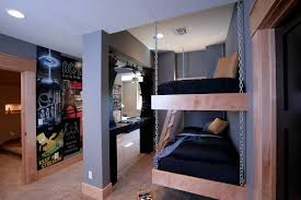 Hanging maple bunk beds looks amazing in this sophisticated boys' room.