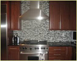 black glass mosaic tile backsplash