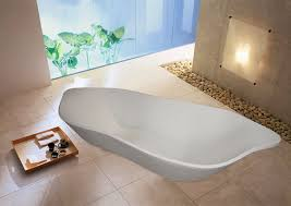 small white fiberglass stand alone soaking tub with stainless