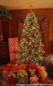 Wrapping Gifts with Plaid Ribbons and Turning on Christmas Trees ...