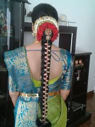 traditional southern indian bride wearing bridal saree jewellery and hairstyle