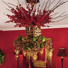 this next chandelier is achieved by attaching wiring a greenery wreath to the bottom of the chandelier then wiring greenery from the top of the