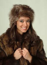 miss nh 2006 was presented the gift of a beautiful fisher fur coat from the new hampshire trappers association by president mel liston
