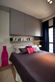 Like the shelving/cupboards above the bed  (decorating small apartments,  space saving furniture and small apartment ideas)