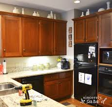 refinish yellowed maple kitchen cabinets new why i repainted my chalk painted cabinets