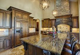 kitchen with modern globe chandeliers over a brown granite island