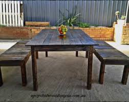 indoor dining table with bench seats. 1.8m x 1m rustic recycled timber dining table and optional bench seats / indoor or outdoor with