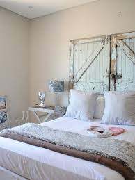 Inspiration for a shabby-chic style bedroom remodel in Other with beige  walls