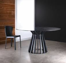 bennett base dining table features a flat round steel frame with wood blossoming wood panels