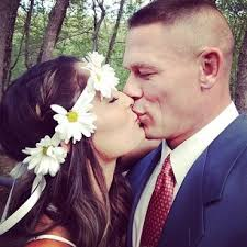 WWE Champion John Cena and Divas Champion Nikki Bella are heating up the small screen starring together on E!'s hit series Total Divas. - john-cena-and-nikki-bella