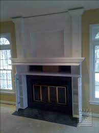 tv framed in over fireplace recessed area for mounting brackets so it hangs flush