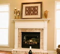 thinking about updating your living room maybe modernizing your fireplace painting your fireplace is definitely a high impact way for homeowners to