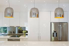 contemporary pendant lighting. Contemporary Pendant Lights Hanging Over Kitchen Island Bench Stock Photo - 37386986 Lighting N