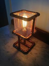 copper pipe desk lamp on a larger scale this might work well for a brazier