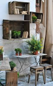 repurposing ideas for outdoor room decor tips and ideas love these old wooden crates filled with plants and books