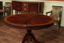 image of wooden round dining table with leaf