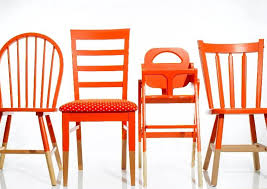 painted red wood dining chairs. mismatched chairs painted the same color unite around a table. red wood dining