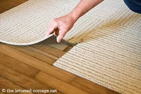 carpet floor tiles. then, wherever four carpet tiles come together, lift the corner edge of one tile up and stick a flor dot to it (sticky side up), using lines floor