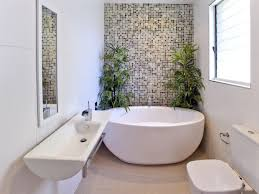 a small narrow space bathroom with round free standing bath wall hung vanity basin nice