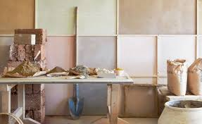 expert guide to plaster in old homes room with exposed walls and bags of plaster