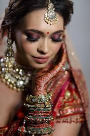photo of bridal makeup with red pink eyes