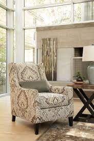 coolly patterned upholstery gives the wilcot accent chair unmistakable glamour sloping back and arms highlight the clean looking design while a thick seat
