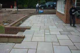 large raised patio and brick retaining wall allscapes start construction