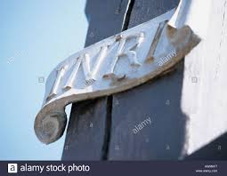 letters inri on crucifix close up AWMKF7