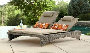 cozy wooden pool lounge chairs in white face to the large swimming