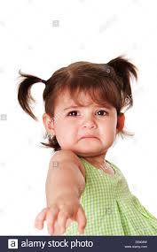 cute baby toddler young little with very sad face expression reaching out for help isolated