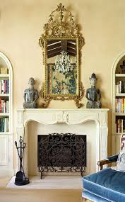 jobeth williams spanish style home gilded mirror hangs above 19th century french fireplace