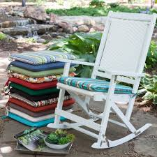 interesting white teak wood stained rocking chair design with cozy outdoor chair cushions in stripped and