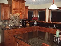 image of cherry kitchen cabinets white island