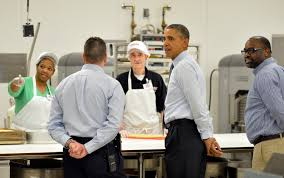 lanham md at costco obama touts his plan to boost wages us president barack obama c s costco bakers behind table as