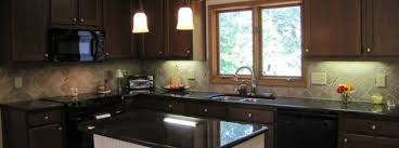 renovated kitchen in cornelius nc in the lake norman area features custom cabinetry granite countertops red oak hardwood floors and a new kitchen island
