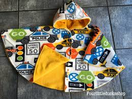 picture of car seat poncho with directional print fleece