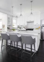 white island with gray leather bar stools