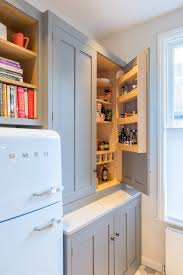 he looks at nearly two dozen solutions and tips for organizing drawers and decluttering utensils such as the tiered drawer insert shown here