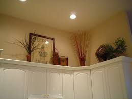 Above Kitchen Cabinet Decorate Above Kitchen Cabinets L Shaped Black Wooden Wall Cabinet